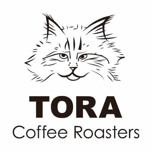Das Logo der Tora Coffee Roasters. Ein handgezeichnetes Porträt der japanischen Hauskatze Tora. Sie wurde zurückgelassen in Österreich, soll aber immer Teil der Kaffeerösterei und der Familie sein, auch in Japan.